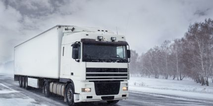 White lorry driving in the snow