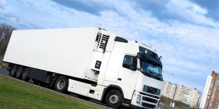White lorry on the side of the road